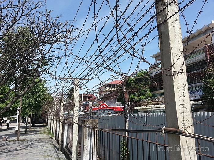 Razor wire around Tuol Sleng Genocide Museum
